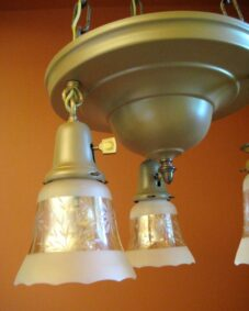 SET of circa-1915 pan-style fixtures. ONE chandelier. PAIR sconces. Glass shades.